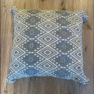 Blue/gold pillow with geometric design